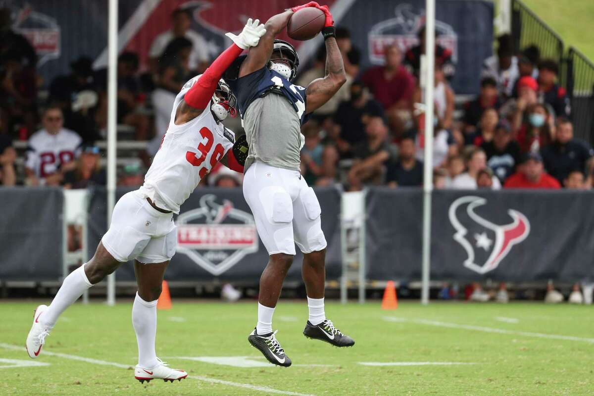 Houston Texans cornerback Terrance Mitchell (39) defends a pass to wide receiver Brandin Cooks (13) during an NFL training camp football practice Tuesday, Aug. 3, 2021, in Houston.