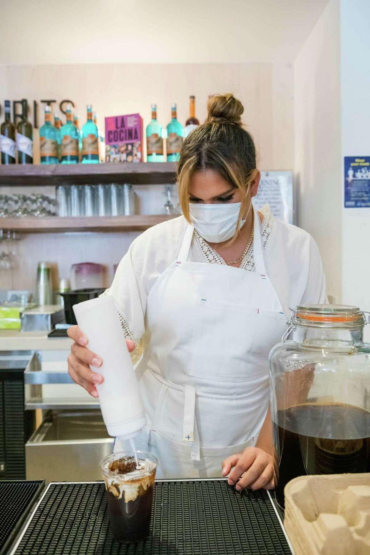 Co-owner Santana Tapia makes a Japanese sweet cream cold brew at Fluid, a new trans-owned cooperative cafe at La Cocina Municipal Marketplace in San Francisco.