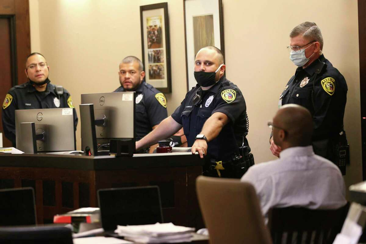 Security remains tight during the fourth day of the punishment phase of the capital murder trial of Otis McKane, in the Bexar County 379th District Court, Tuesday, Aug. 3, 2021. McKane was found guilty in the murder of San Antonio police Det. Benjamin Marconi on Nov. 20, 2016, in front of the San Antonio Public Safety Headquarters. The prosecution will continue on Wednesday.