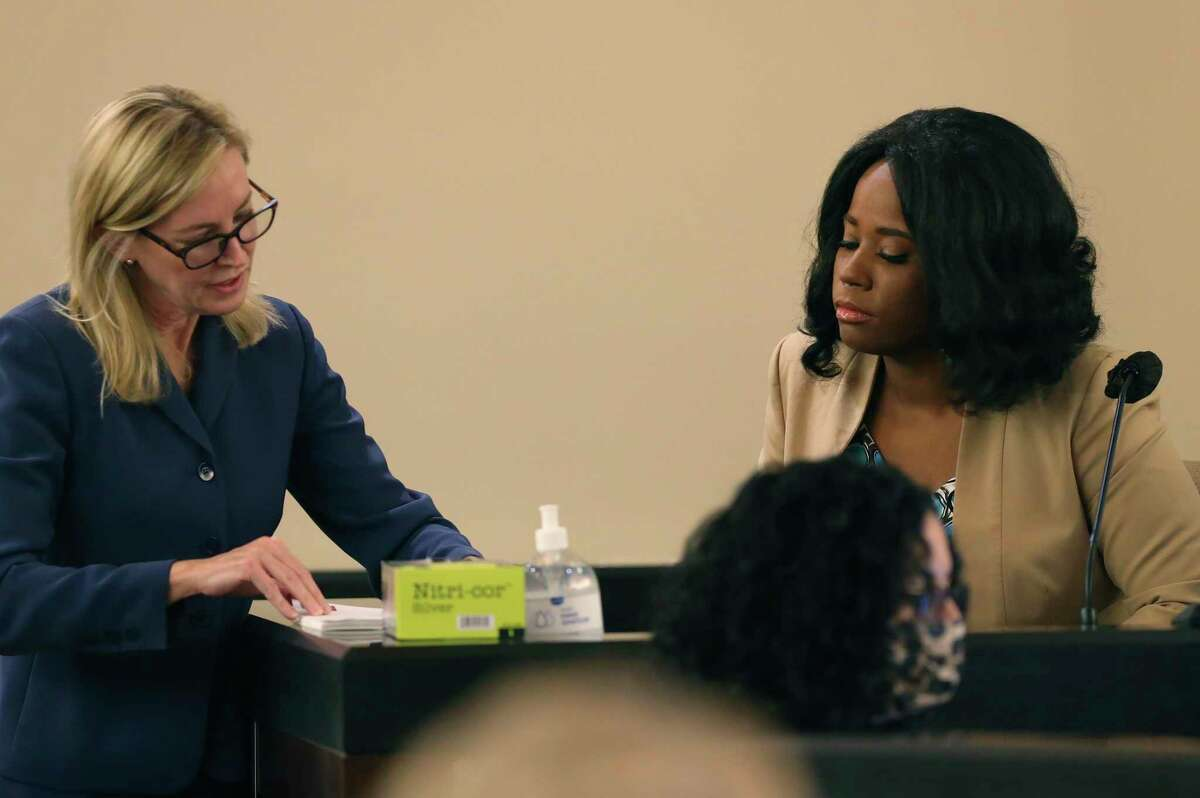 Prosecutor Tamara Strauch, left, goes over evidence with Saharia Paillett-Hill on the fourth day of the punishment phase in the capital murder trial of Otis McKane in the Bexar County 379th District Court, Tuesday, Aug. 3, 2021. Paillett-Hill is the ex-girlfriend and mother of McKane?•s son. McKane was found guilty in the murder of San Antonio police Det. Benjamin Marconi on Nov. 20, 2016 in front of the San Antonio Public Safety Headquarters.