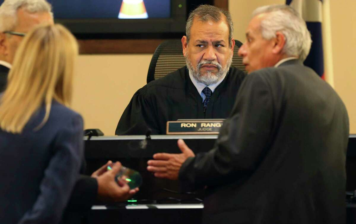 The prosecution and defense approach the bench to talk with Bexar County 379th District Court Judge Ron Rangel during the fourth day of the punishment phase in the capital murder trial of Otis McKane, Tuesday, Aug. 3, 2021. McKane was found guilty in the murder of Marconi on Nov. 20, 2016, in front of the San Antonio Public Safety Headquarters. The prosecution will continue on Wednesday.