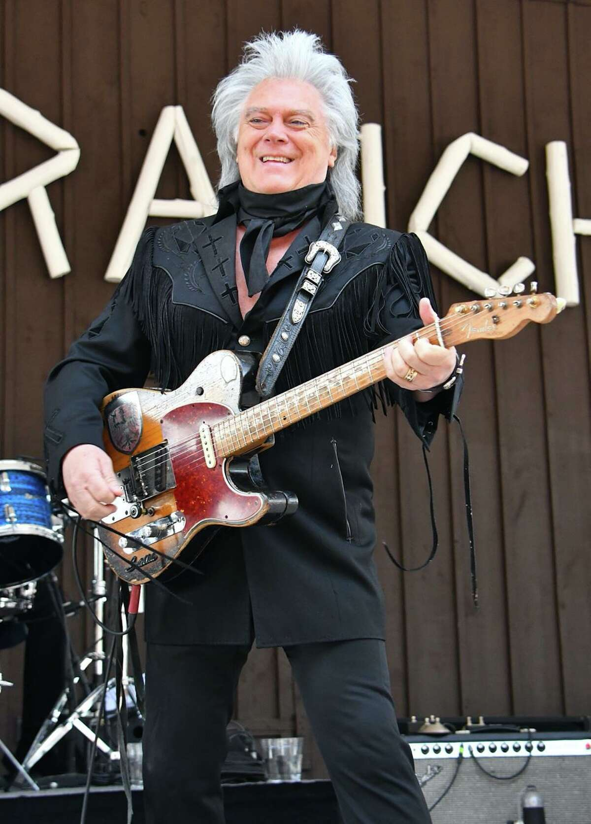 """Singer, songwriter and musician Marty Stuart is shown performing on stage during his July 31 concert at Indian Ranch. Stuart has been active since 1968, and initially toured with Lester Flatt, and then in Johnny Cash's road band before beginning work as a solo artist in the early 1980s. His greatest commercial success came in the first half of the 1990s on MCA Records Nashville. He has recorded over 20 studio albums, and has charted over 30 times on the Billboard Hot Country Songs charts. His highest chart entry is """"The Whiskey Ain't Workin"""", a duet with Travis Tritt. Stuart has also won five Grammy Awards out of 16 nominations. He is known for his combination of rockabilly, country rock and bluegrass music influences, his frequent collaborations and cover songs, and his distinctive stage dress. Stuart is also a member of the Grand Ole Opry and the Country Music Hall of Fame. To learn more about Marty Stuart and his Fabulous Superlatives, visit www.martystuart.net"""