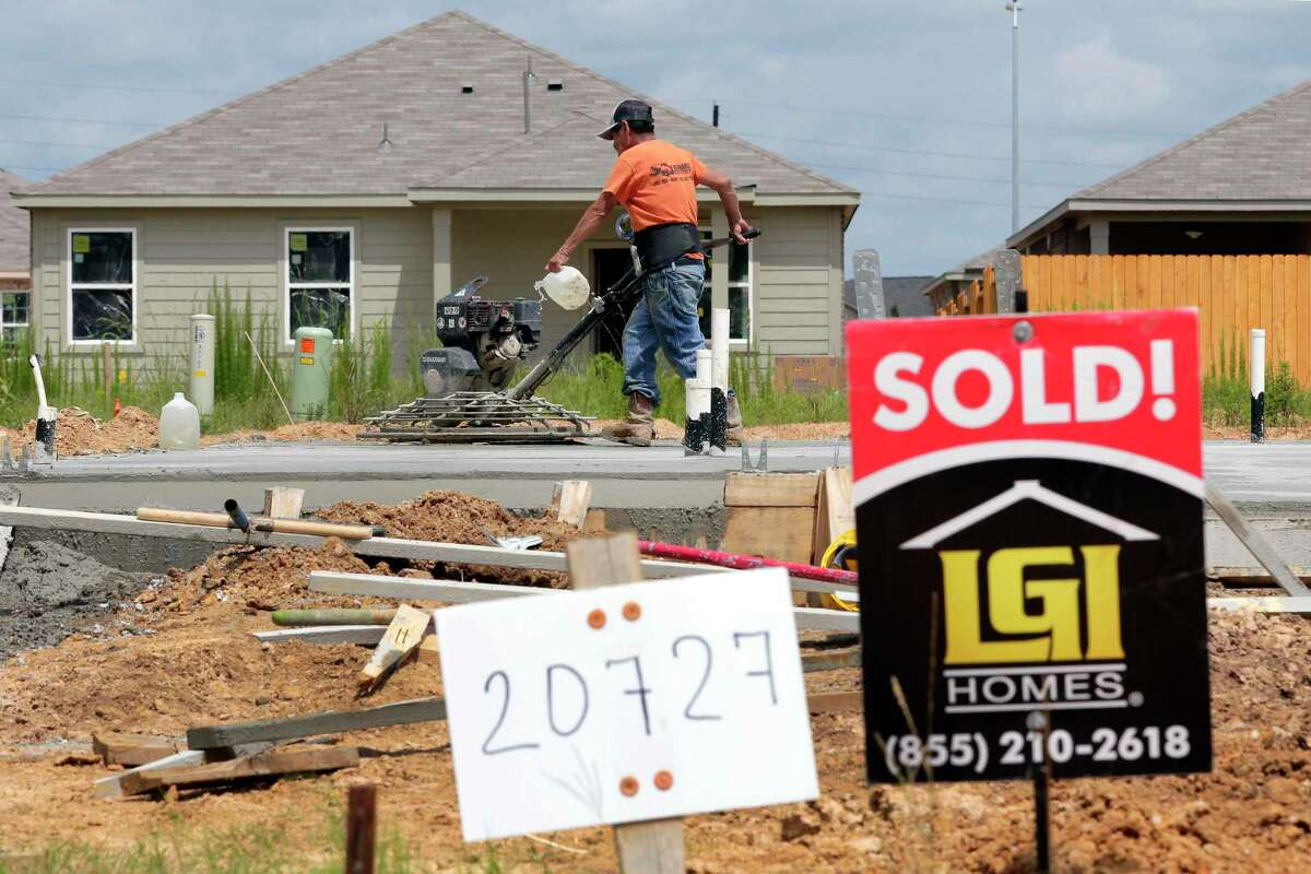 Construction workers put down concrete foundations for new houses of LGI Homes along Sunshine Meadow Drive in June in Hockley Homebuilders are dealing with the challenges of a red-hot housing market and rising material prices.