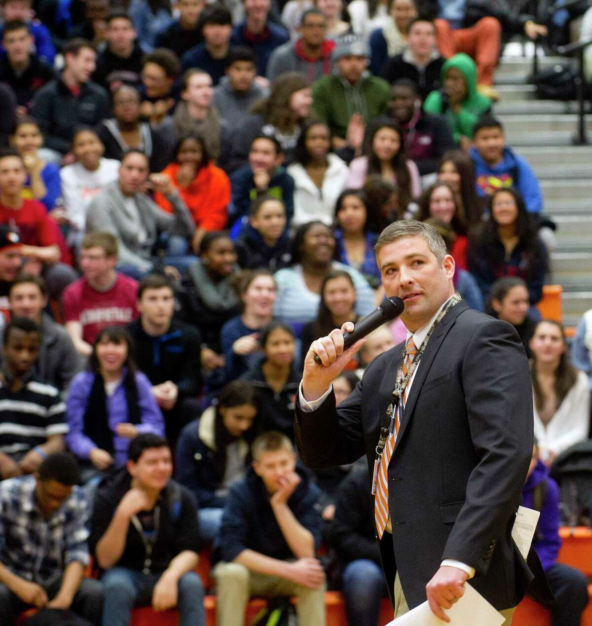 Then-assistant principal Matthew Forker speaks during an assembly aimed to increase school pride on Friday, February 20, 2015.