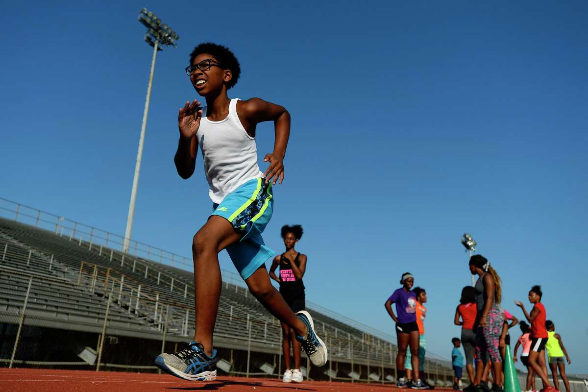 Runners start their run as part of their work out at the Beaumont Track Club's practice at Babe Zaharias Stadium. Photo taken Tuesday 7/24/18 Ryan Pelham/The Enterprise