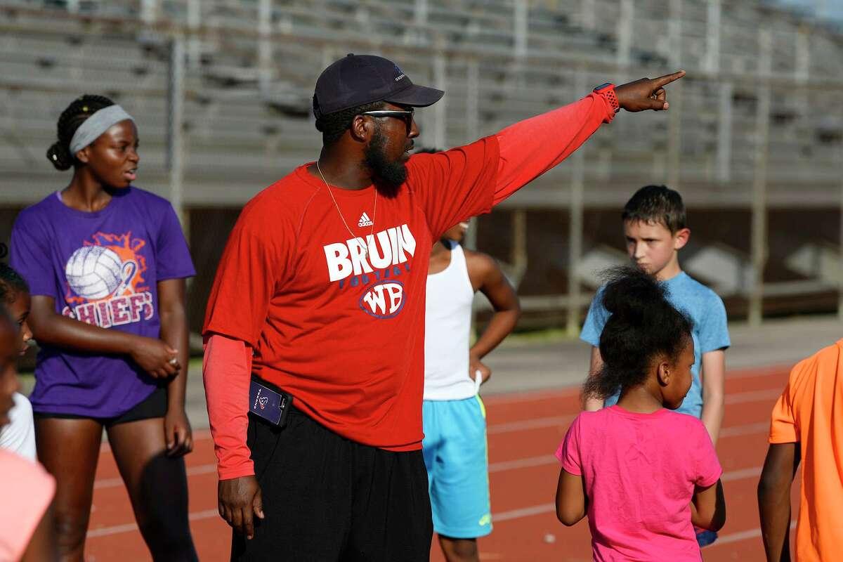 Renwick Johnson gives athletes directions at the Beaumont Track Club's practice at Babe Zaharias Stadium. Photo taken Tuesday 7/24/18 Ryan Pelham/The Enterprise