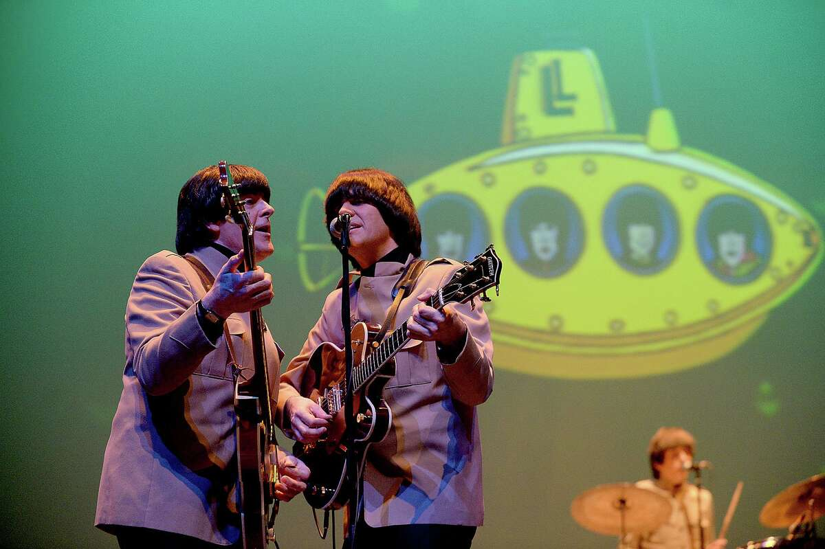 The Liverpool Legends Beatles Tribute Band perform Wednesday night at the Jefferson Theatre. The band made a return to Beaumont, bringing the sights and sounds of the Fab Four to the stage. The group, whose members were hand-picked by Louise Harrison, sister of the late George Harrison, have performed to critical acclaim at venues throughout the world, including half time at the 2014 Rose Bowl, the Boston Pops, Carnegie Hall, and the Abbey Road Studios in London. The group performed numbers spanning the history of the Beatles, including solo work by members of the group after their disbanding. Photo taken Tuesday, February 7, 2017 Kim Brent/The Enterprise