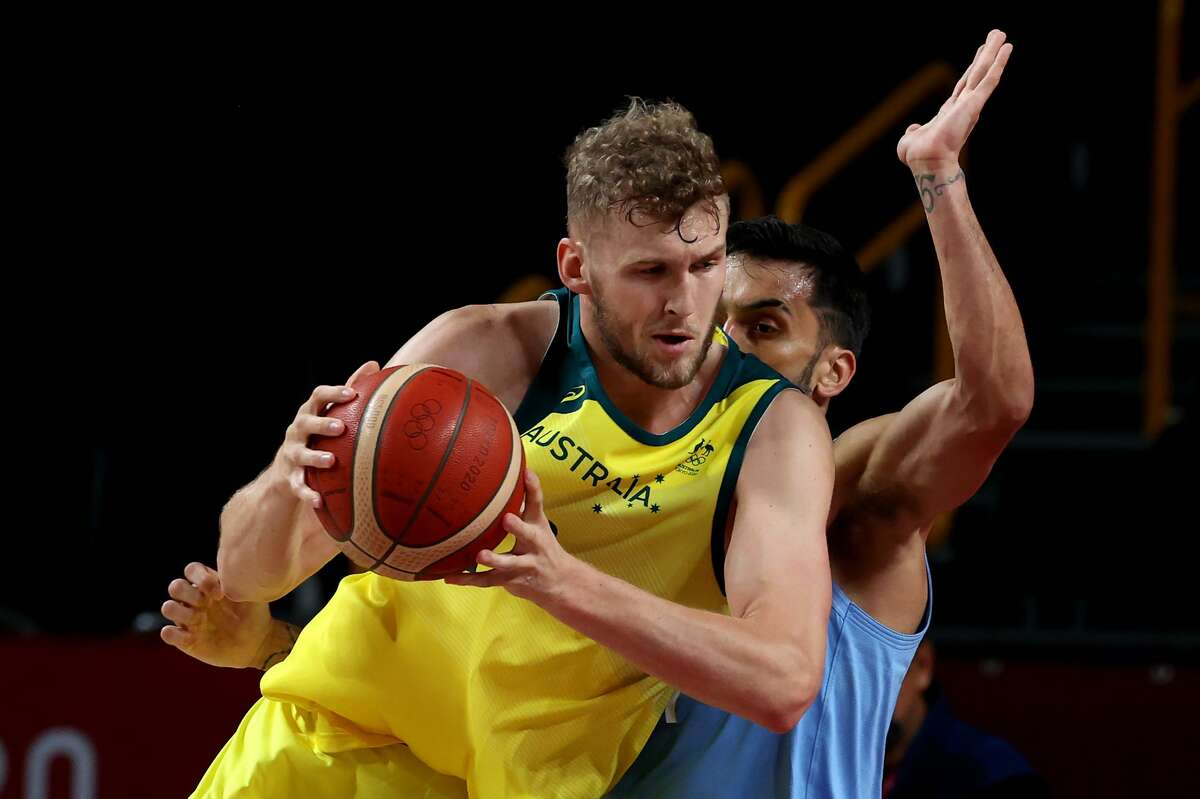 Jock Landaleof Team Australia drives to the basket against Facundo Campazzo of Team Argentina during the first half at the Tokyo 2020 Olympic Games at Saitama Super Arena on August 03, 2021 in Saitama, Japan.