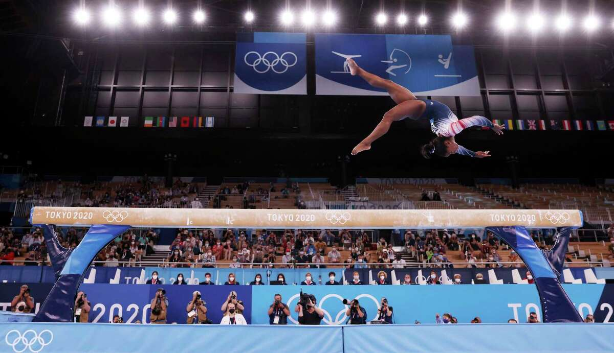 Combo cutlinexxxTOKYO, JAPAN - AUGUST 03: Simone Biles of Team United States competes in the Women's Balance Beam Final on day eleven of the Tokyo 2020 Olympic Games at Ariake Gymnastics Centre on August 03, 2021 in Tokyo, Japan. (Photo by Jamie Squire/Getty Images)