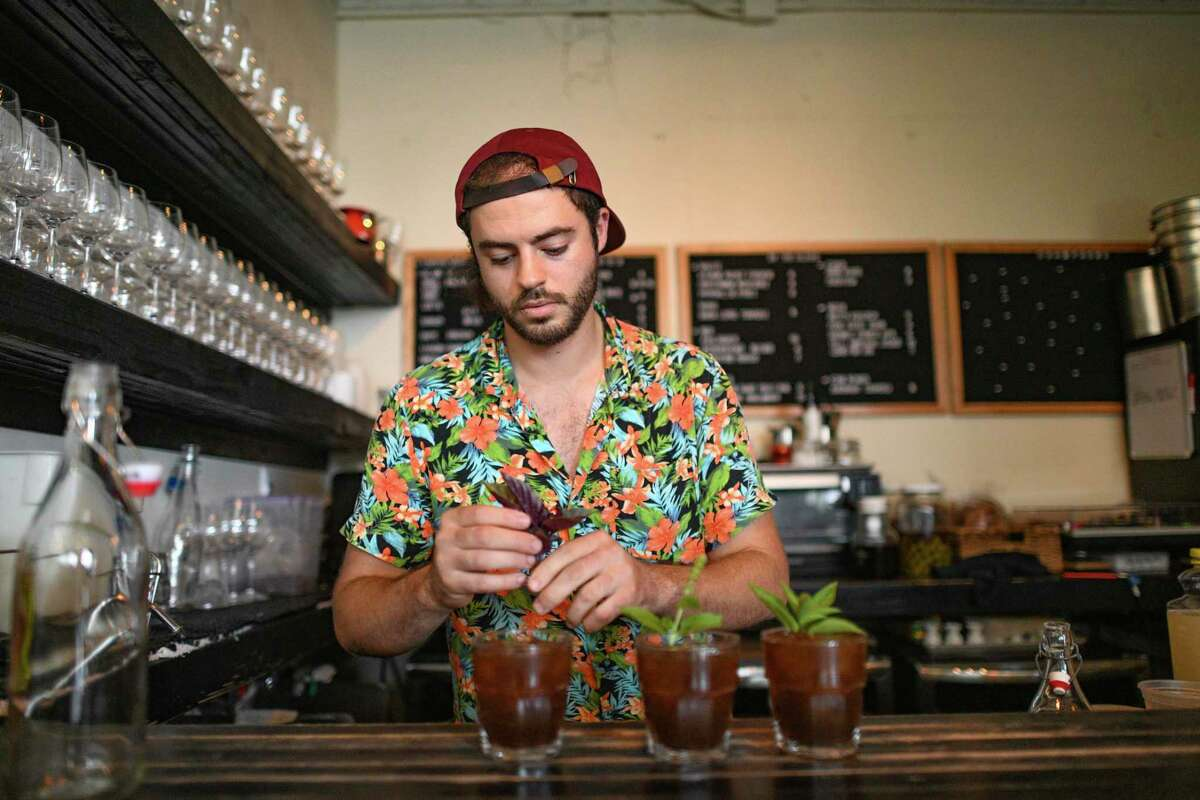 Solomo Gerges is the owner of Eclipse Coffee on the St. Mary's strip. He prepares drinks on Thursday, July 22, 2021.