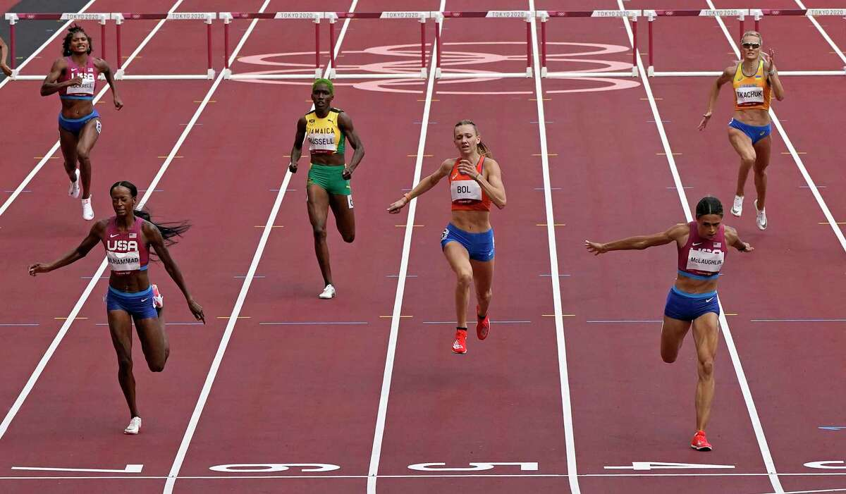 Sydney Mclaughlin, of United States wins the gold medal in the final of the the women's 400-meter hurdles ahead of Dalilah Muhammad, of United States, silver, and Femke Bol, of Netherlands, bronze, at the 2020 Summer Olympics, Wednesday, Aug. 4, 2021, in Tokyo, Japan.