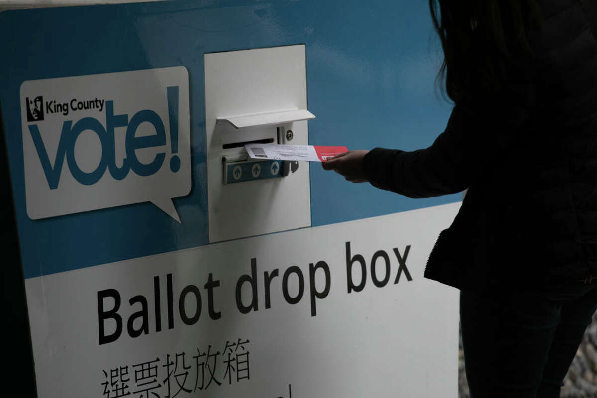 A voter casts her ballot during primary elections on March 10, 2020 in Seattle, Washington. Although most Washington State ballots are mailed-in, many people deposit their votes in ballot drop boxes throughout the state.