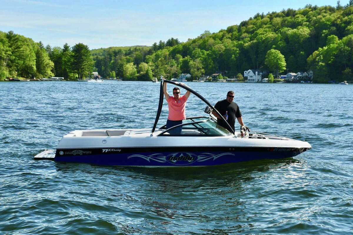 """Boaters enjoy a day on Highland Lake in Winsted last year. Litchfield County on Tuesday joined the rest of the state in having """"substantial"""" threats of COVID-19 spread."""