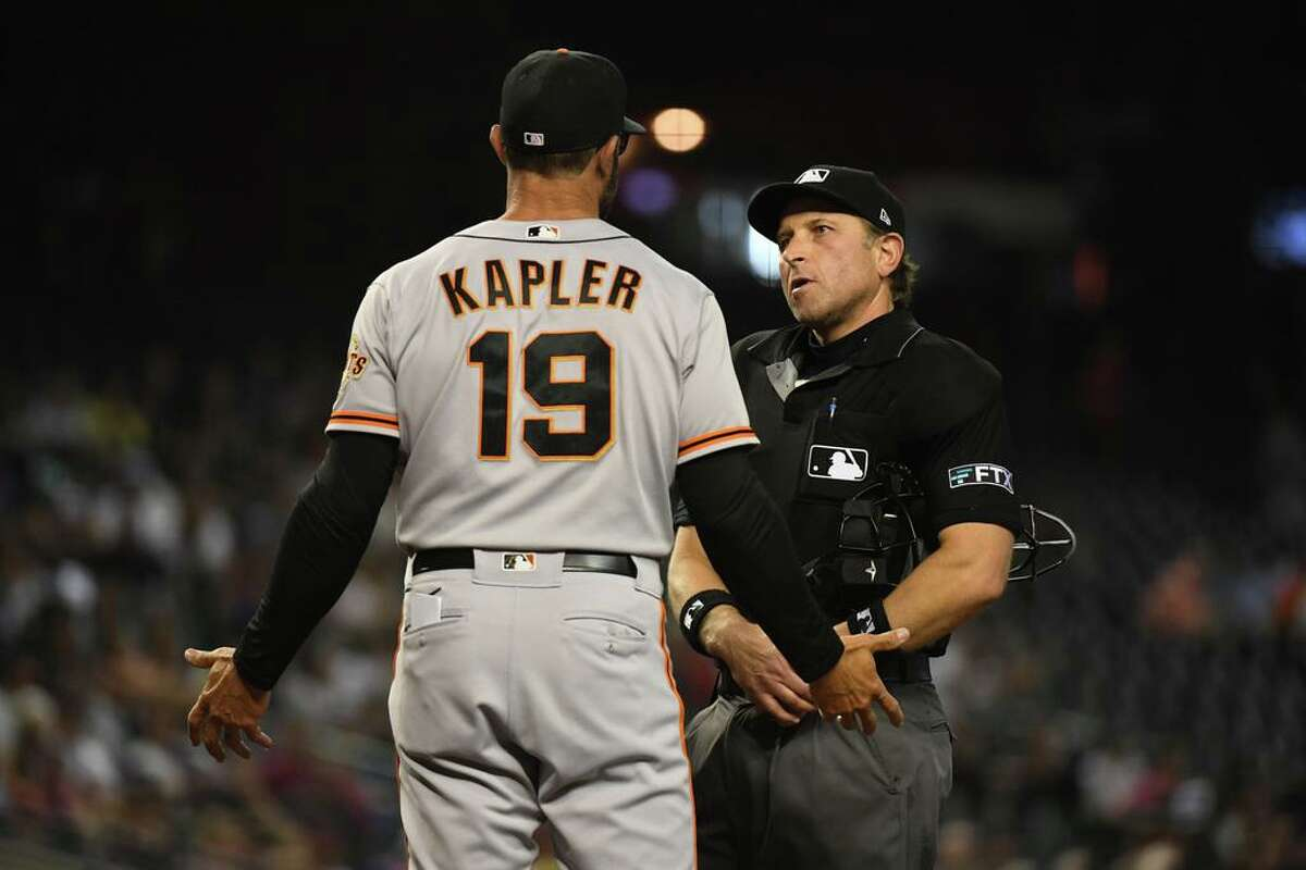 PHOENIX, ARIZONA - AUGUST 03: Manager Gabe Kapler #19 of the San Francisco Giants talks with home plate umpire Chris Guccione #68 after catcher Curt Casali was called for an equipment violation against the Arizona Diamondbacks during the second inning at Chase Field on August 03, 2021 in Phoenix, Arizona. (Photo by Norm Hall/Getty Images)