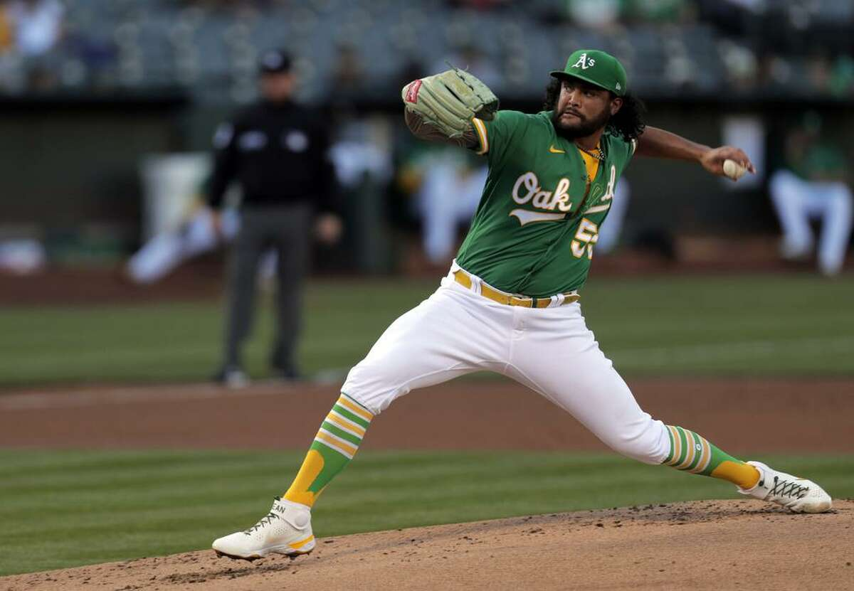 Pitcher Sean Manaea (55) throws in the first inning as the Oakland Athletics played the San Diego Padres at the Coliseum in Oakland, Calif., on Tuesday, August 3, 2021.
