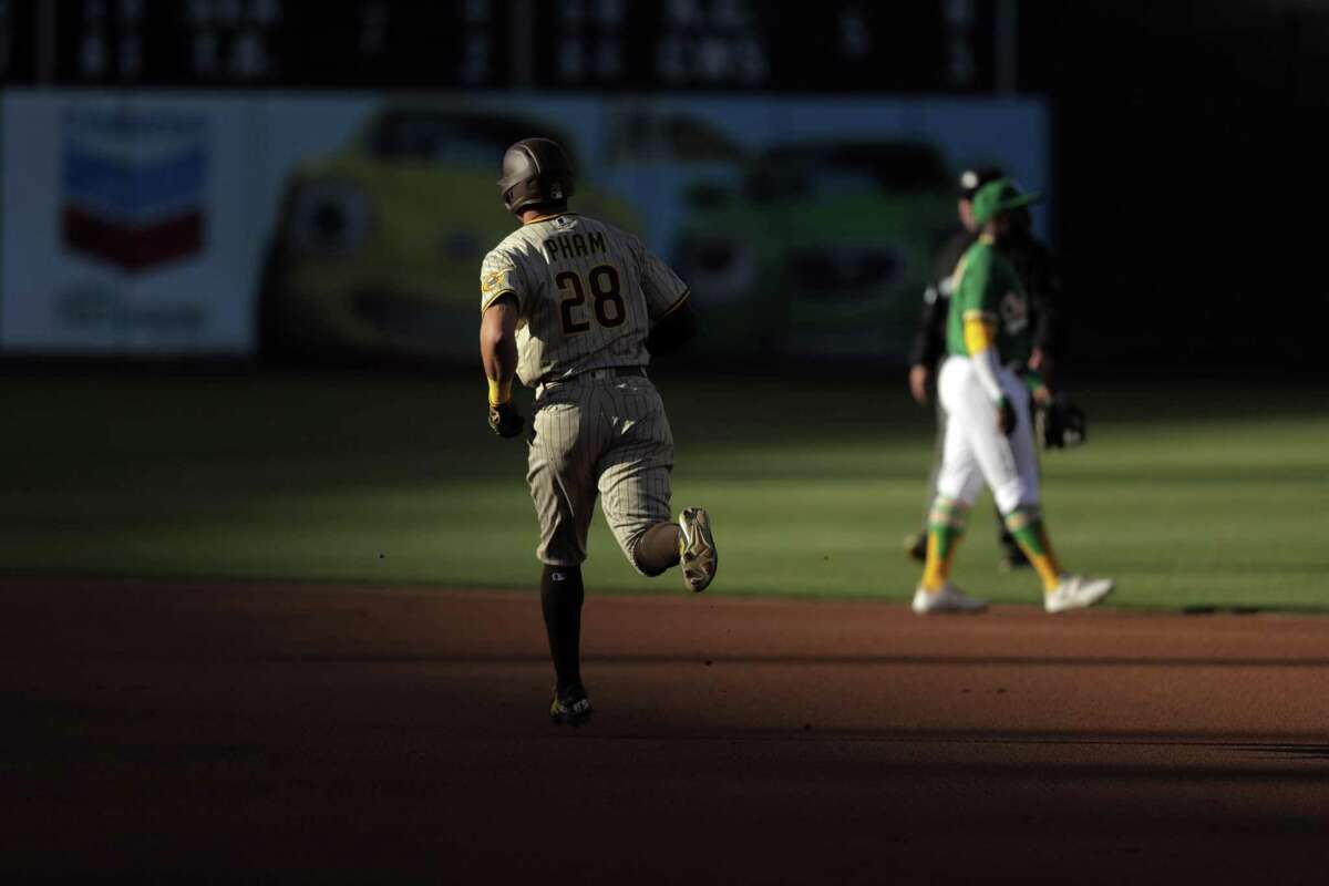 Tommy Pham (28) rounds the bases after hitting a solo homerun in the first inning as the Oakland Athletics played the San Diego Padres at the Coliseum in Oakland, Calif., on Tuesday, August 3, 2021.