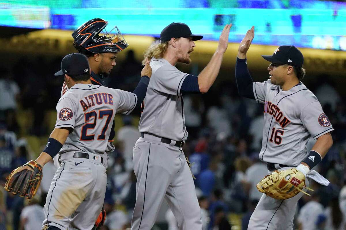 Ryne Stanek (center) and Almedys Diaz (right) celebrate the Astros' 3-0 victory over the Dodgers on Tuesday night in Los Angeles.