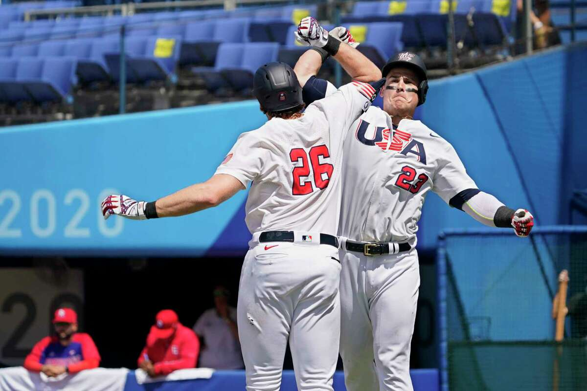 United States' Tyler Austin (23) celebrates his home run with teammate Triston Casas (26) in the fifth inning of a baseball game against the Dominican Republic at the 2020 Summer Olympics, Wednesday, Aug. 4, 2021, in Yokohama, Japan.