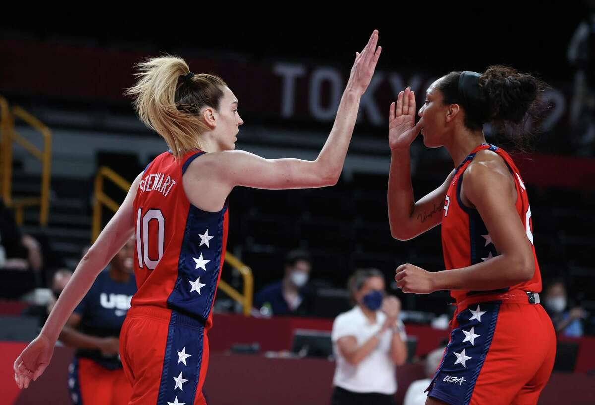 SAITAMA, JAPAN - AUGUST 04: Breanna Stewart #10 of Team United States high-fives teammate A'Ja Wilson #9 during the first half of a Women's Basketball Quarterfinals game on day twelve of the Tokyo 2020 Olympic Games at Saitama Super Arena on August 04, 2021 in Saitama, Japan. (Photo by Kevin C. Cox/Getty Images)