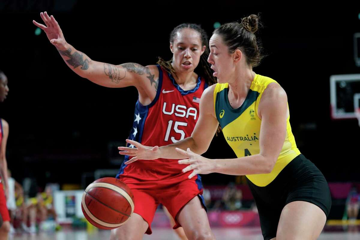 Australia's Jenna O'Hea (4) drives past United States's Brittney Griner (15) during a women's basketball quarterfinal round game at the 2020 Summer Olympics, Wednesday, Aug. 4, 2021, in Saitama, Japan. (AP Photo/Charlie Neibergall)