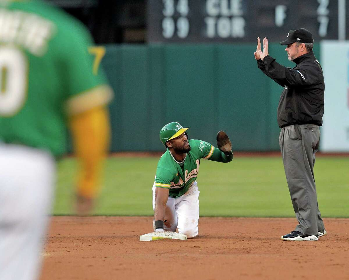 Starling Marte (2) calls for time after stealing second in the third inning as the Oakland Athletics played the San Diego Padres at the Coliseum in Oakland, Calif., on Tuesday, August 3, 2021.