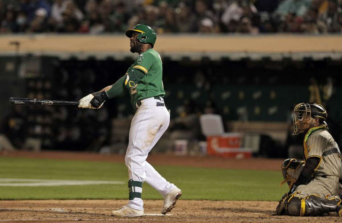 Starling Marte (2) watches his solo homerun in the fifth inning as the Oakland Athletics played the San Diego Padres at the Coliseum in Oakland, Calif., on Tuesday, August 3, 2021.