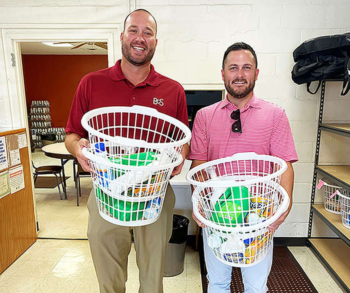 Main Street Community Center volunteers Tanner Alexander, left, and Jeff Patrick, both from Bank of Springfield, delivered laundry baskets and supplies to seniors last month as part of the Madison County CARES Grant program.