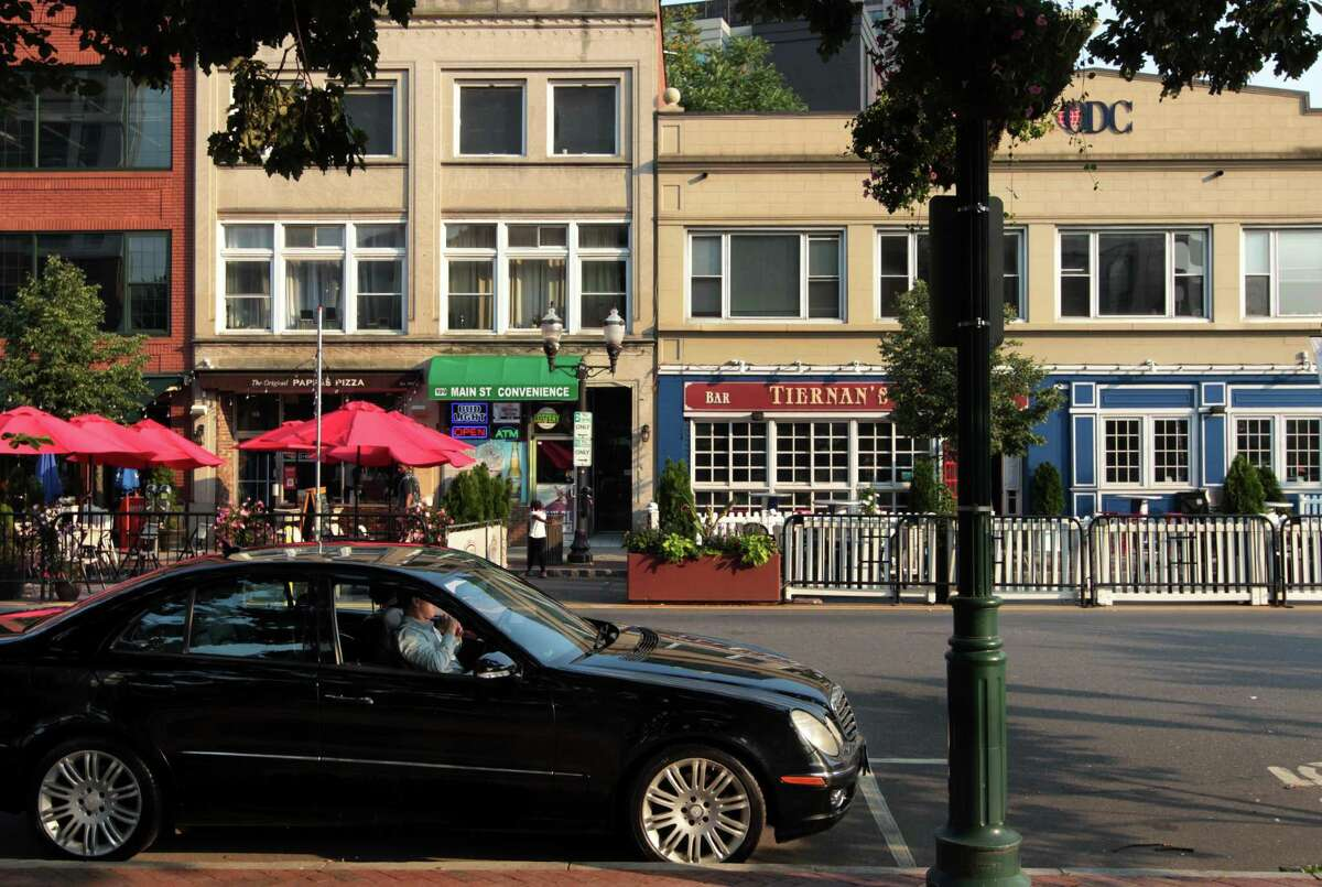 Views of businesses surrounding Columbus Park in Stamford, Conn.