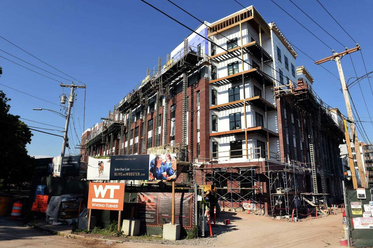 The Olive & Wooster Apartments under construction at the corner of Fair and Union Street in New Haven on June 30, 2021. The same developer wants to build a new, seven-story, 186-unit, 157,895-square-foot, mixed-use structure at 20 and 34 Fair St.