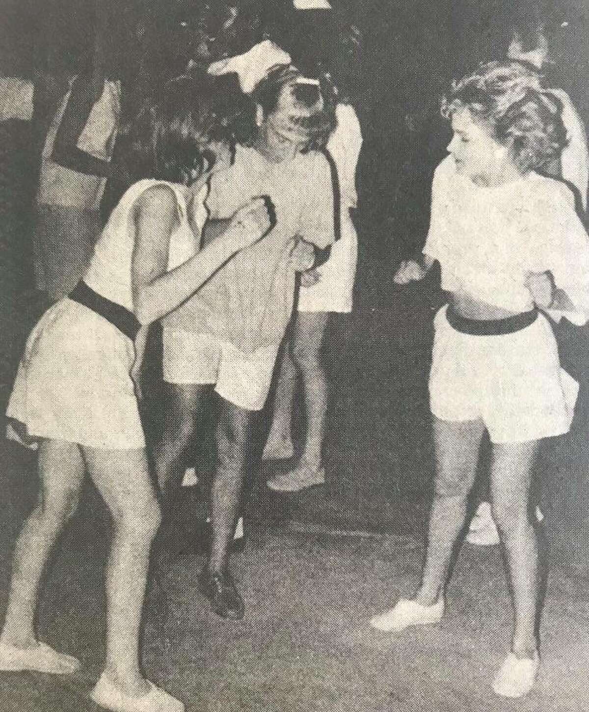 Laura Schoren, 14, left, Maggie Tancini, 14, and Tonya Weiger, 15, at a teen dance, sponsored by Midland Parks and Recreation Department. June 1988