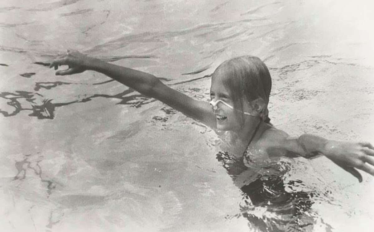 Debbie Joynt, 10, comes up for air while enjoying the pool at Plymouth Park in August 1984.