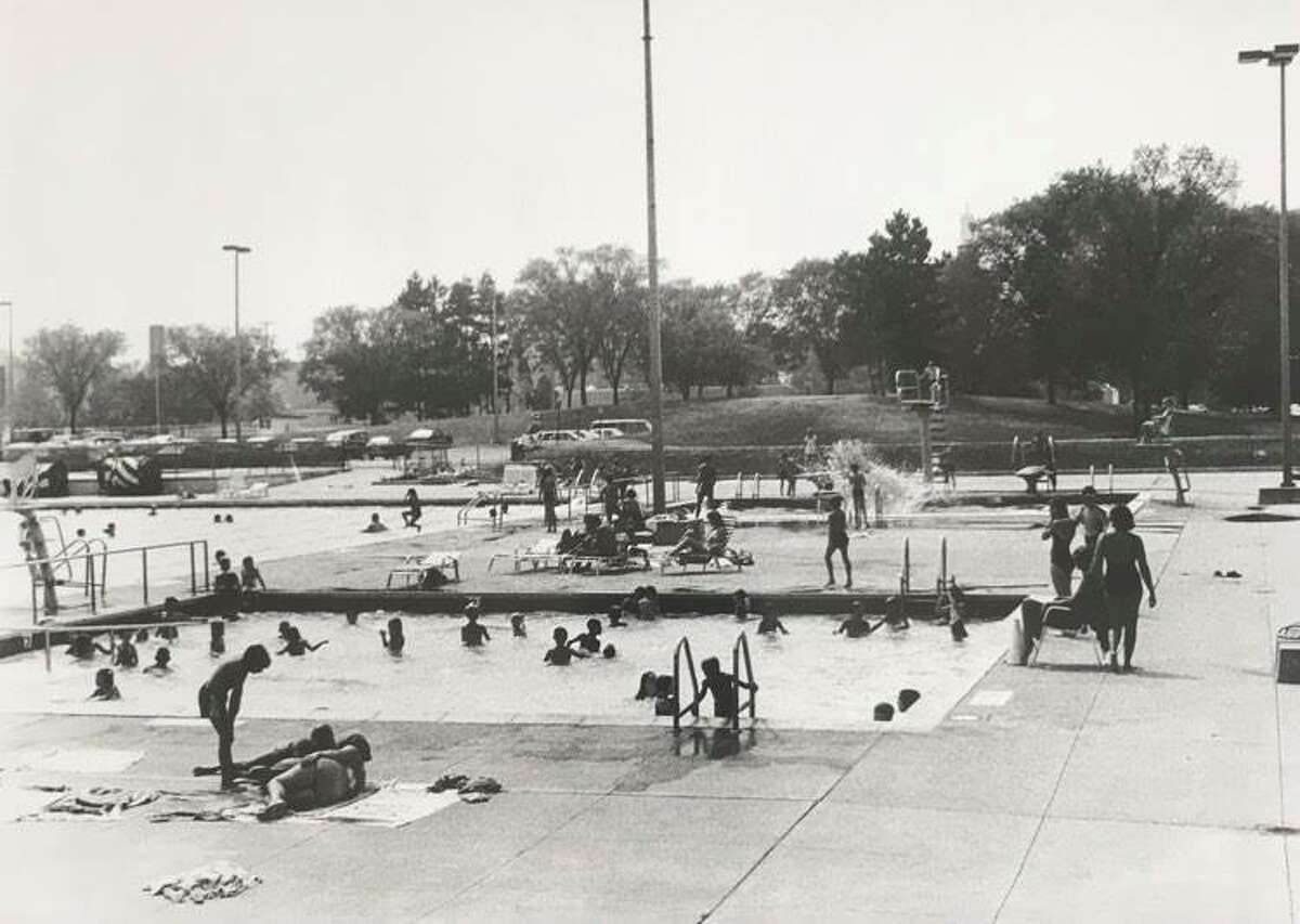 Central Park's swimming facilities are suited for young children, foreground, ambitious divers, background right, and older swimmers, background left. Lifeguards supervise all three areas. August 1984