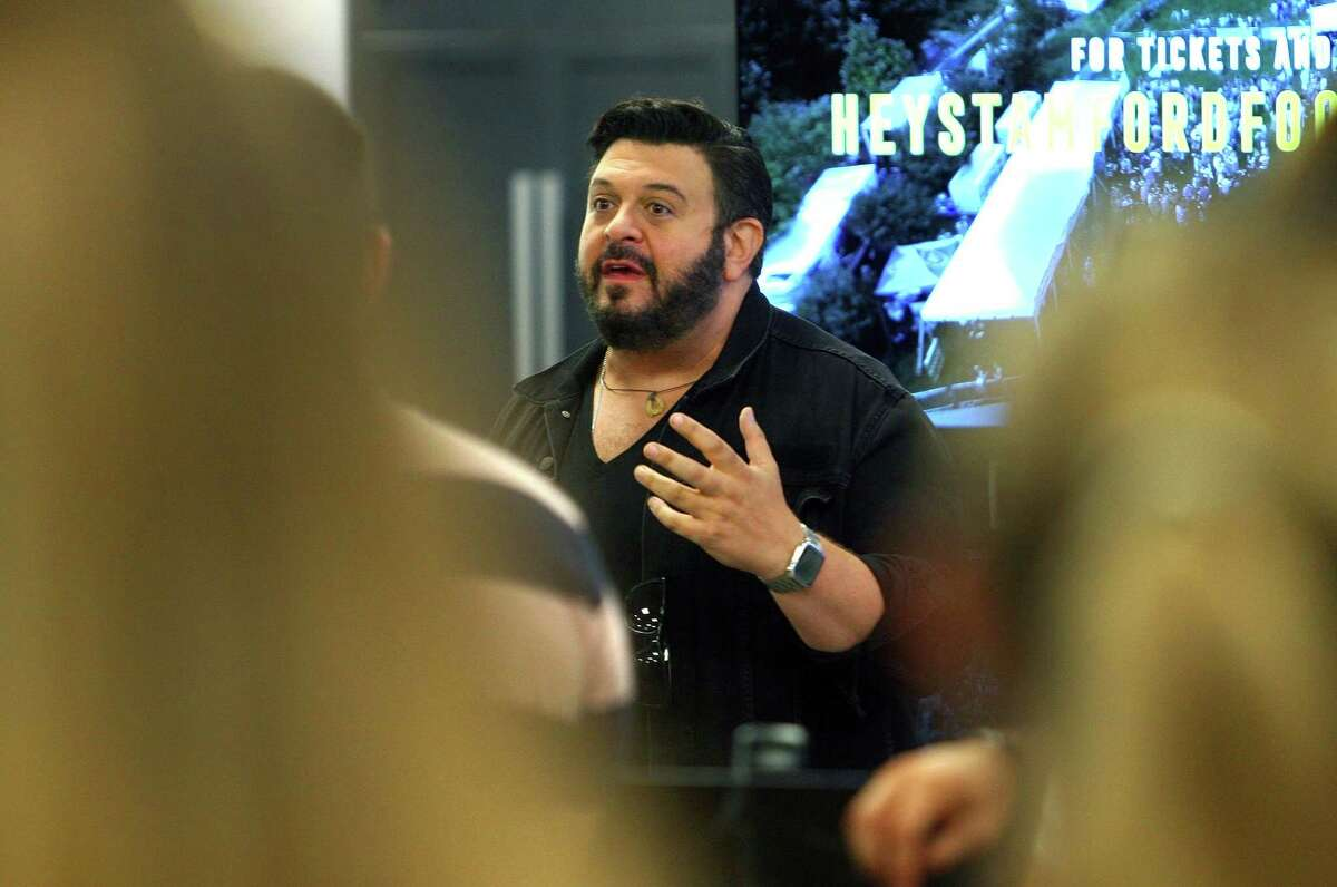 Adam Richman, the original host of Man v. Food, speaks during the kick-off event to the Hey Stamford! Food Festival held at County TV & Appliance in Stamford, Conn., on Tuesday August 3, 2021. The 2021 Hey Stamford! Food Festival will take place over two weekends from Thursday, August 12 - Sunday, August 15 and Thursday, August 19 - Sunday, August 22 at Mill River Park in downtown Stamford, CT.