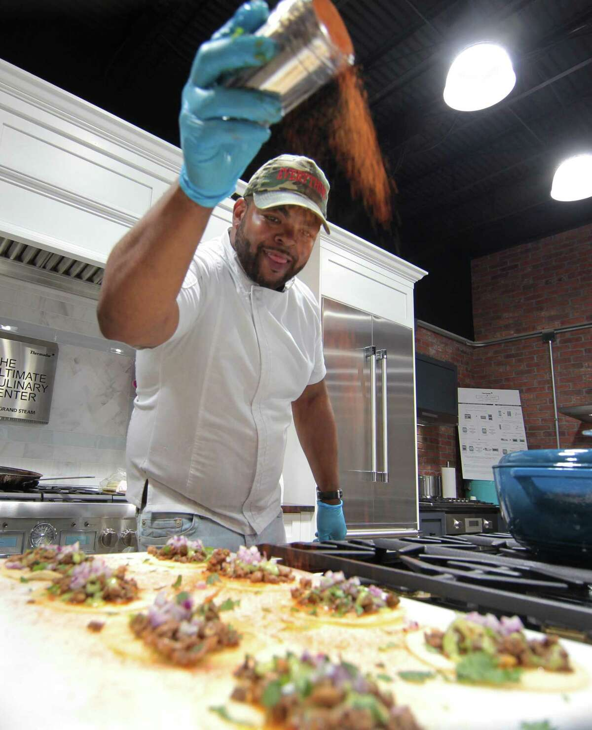 Taco Daddy's Chef Mo Major prepares food for guests during the kick-off event to the Hey Stamford! Food Festival held at County TV & Appliance in Stamford, Conn., on Tuesday August 3, 2021. The 2021 Hey Stamford! Food Festival will take place over two weekends from Thursday, August 12 - Sunday, August 15 and Thursday, August 19 - Sunday, August 22 at Mill River Park in downtown Stamford, CT.