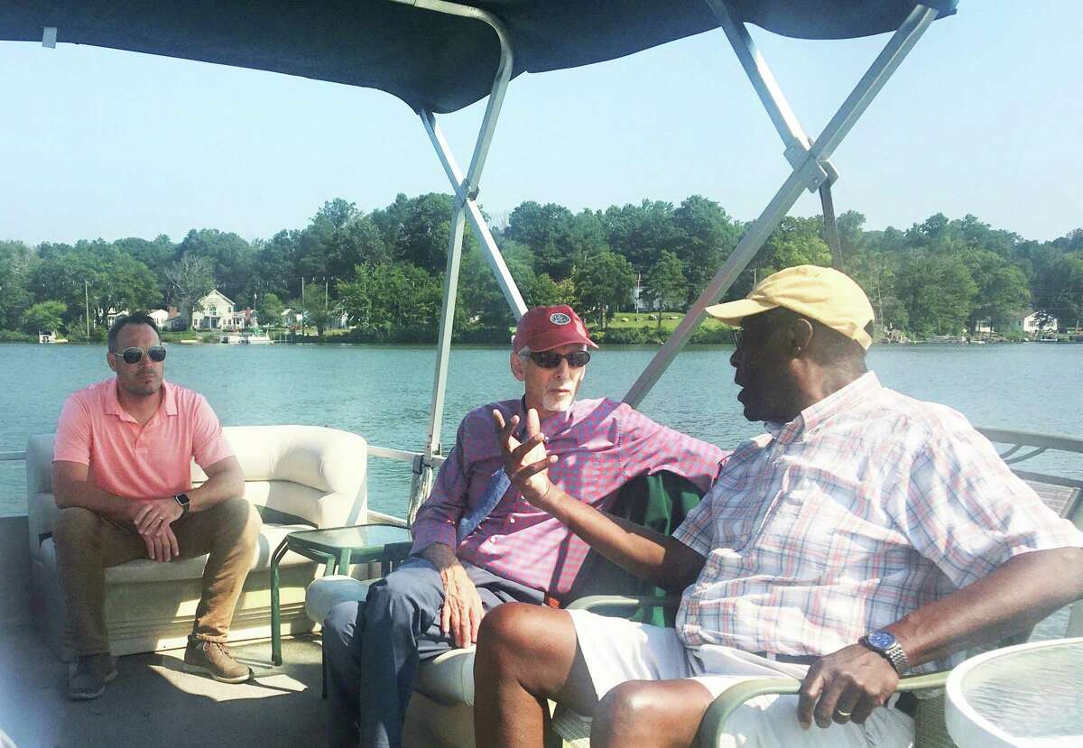 State Sen. Norm Needleman, D-Essex, center, recently joined East Hampton leaders on a tour of Lake Pocotopaug.