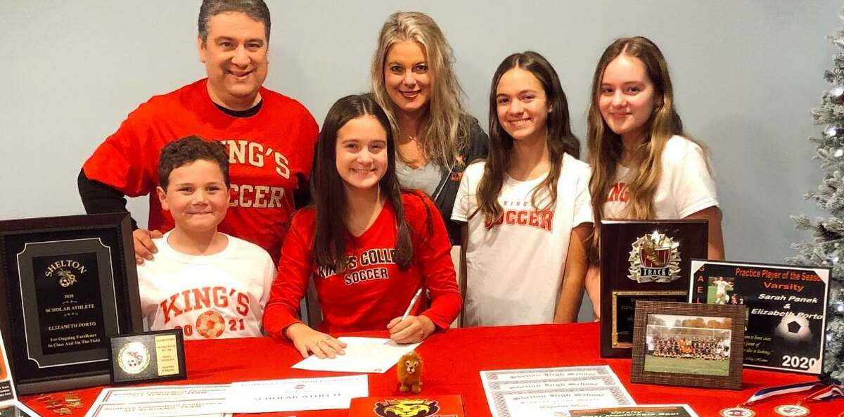 Liz Porto signs to play soccer at King's College (PA). Joining the SCC All-Division midfielder are dad Ron, mom Kathleen, brother Jack and sisters Susie and Mary.