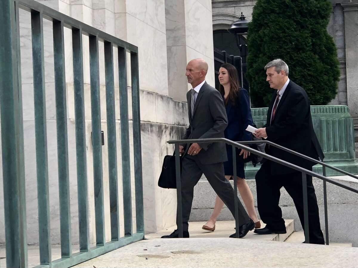 Former MyPayrollHR CEO Michael Mann, right, arrives at U.S. District Court to be sentenced in the $100 million fraud case that brought down his company.