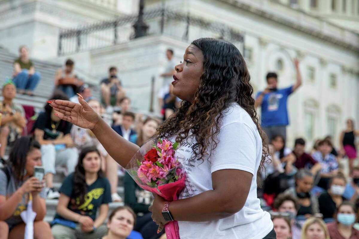 FILE - Rep. Cori Bush, D-Mo., speaks to crowds that attended a sit-in at Capitol Hill after it was announced that the Biden administration will enact a targeted nationwide eviction moratorium outside of Capitol Hill in Washington on Tuesday, August 3, 2021.