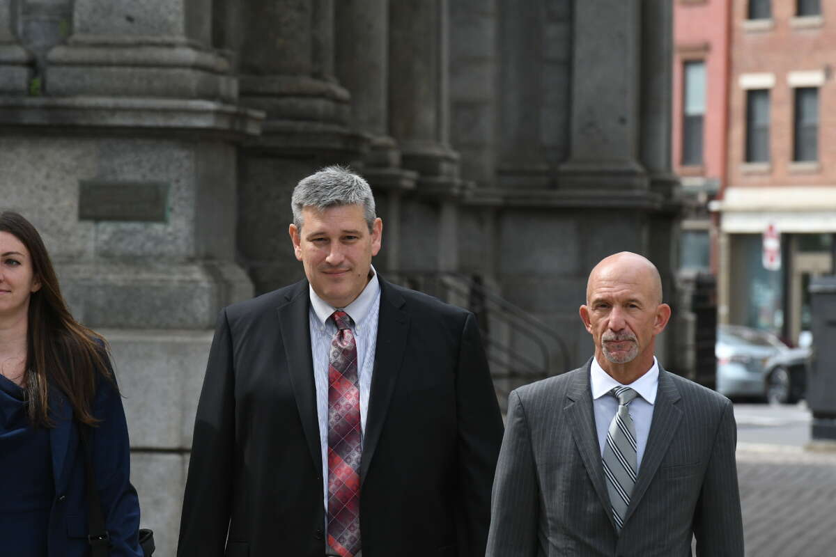 Former MyPayrollHR CEO Michael Mann, center, arrives at U.S. District Court with his attorneys to be sentenced in the $100 million fraud case that brought down his company. One of his alleged accomplices, Derek R. Schwartz of Texas, was indicted in the scheme this week.