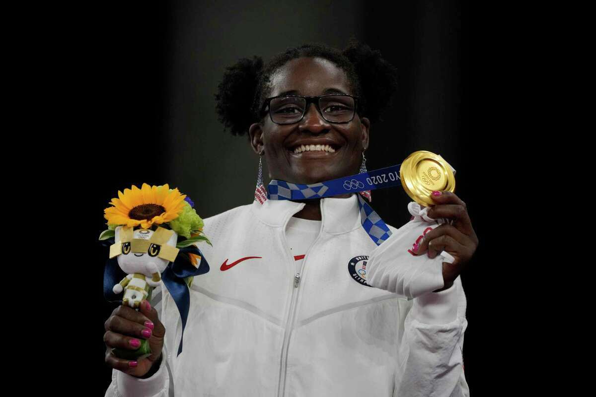 Tamyra Mensah-Stock with her gold medal and hair still in its 'puffballs.'
