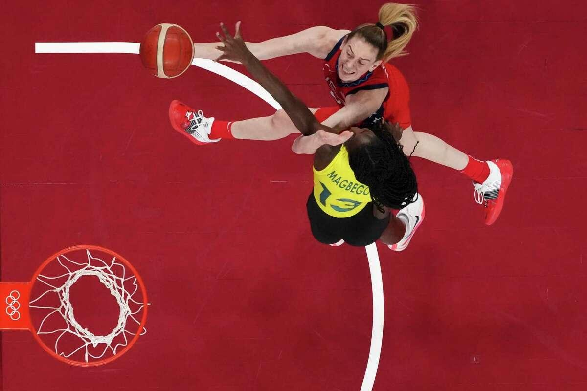 Breanna Stewart drives to the basket over Australia's Ezi Magbegor in the U.S. quarterfinal victory.