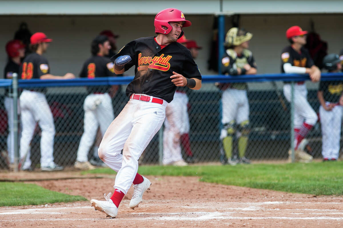 Berryhill's Al Money scores a run during a July 23, 2021 American Legion Zone 4 tournament game against Petoskey.