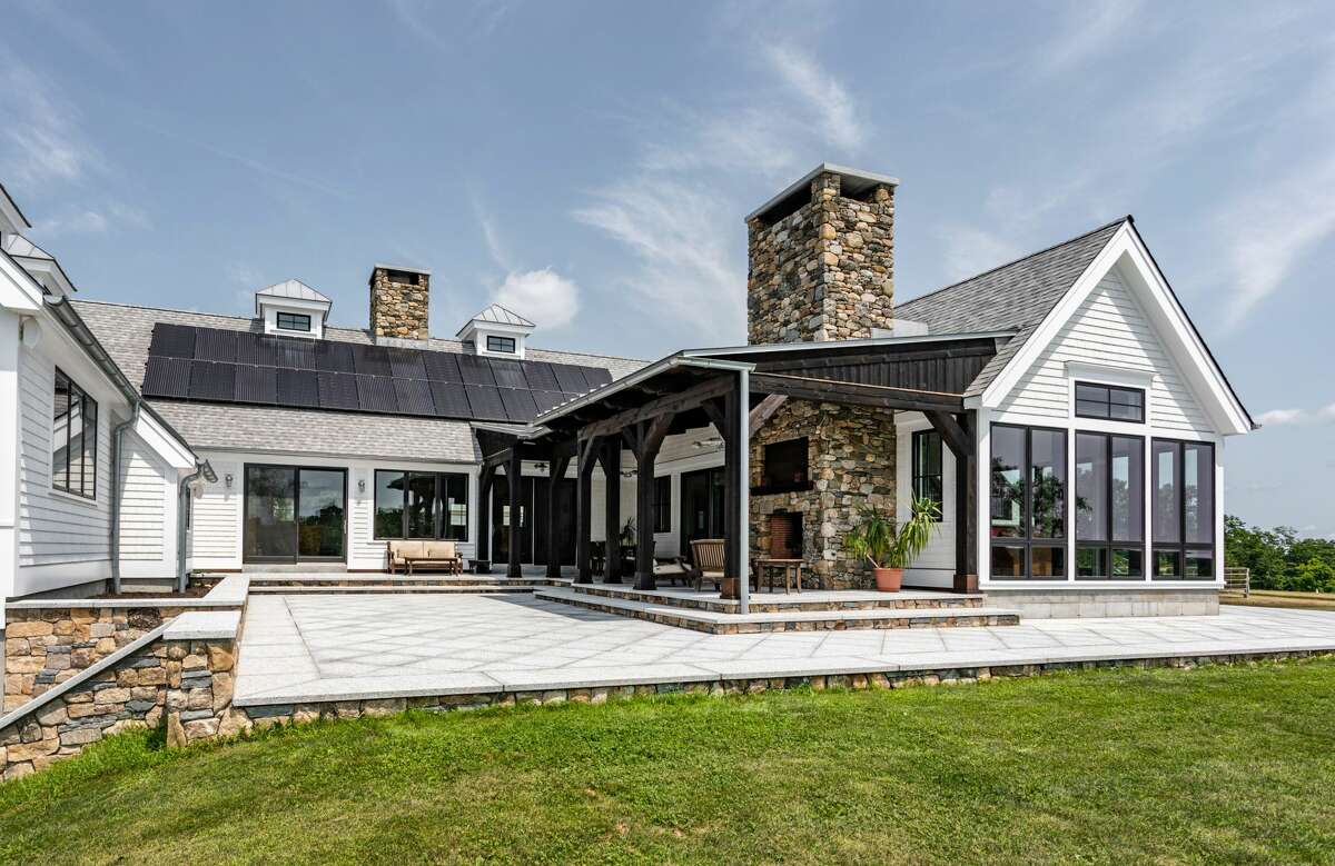 The homehas an additional 2,300 square feet of private, outdoor living space that features a stone wood burning fireplace and a cedar timber porch.