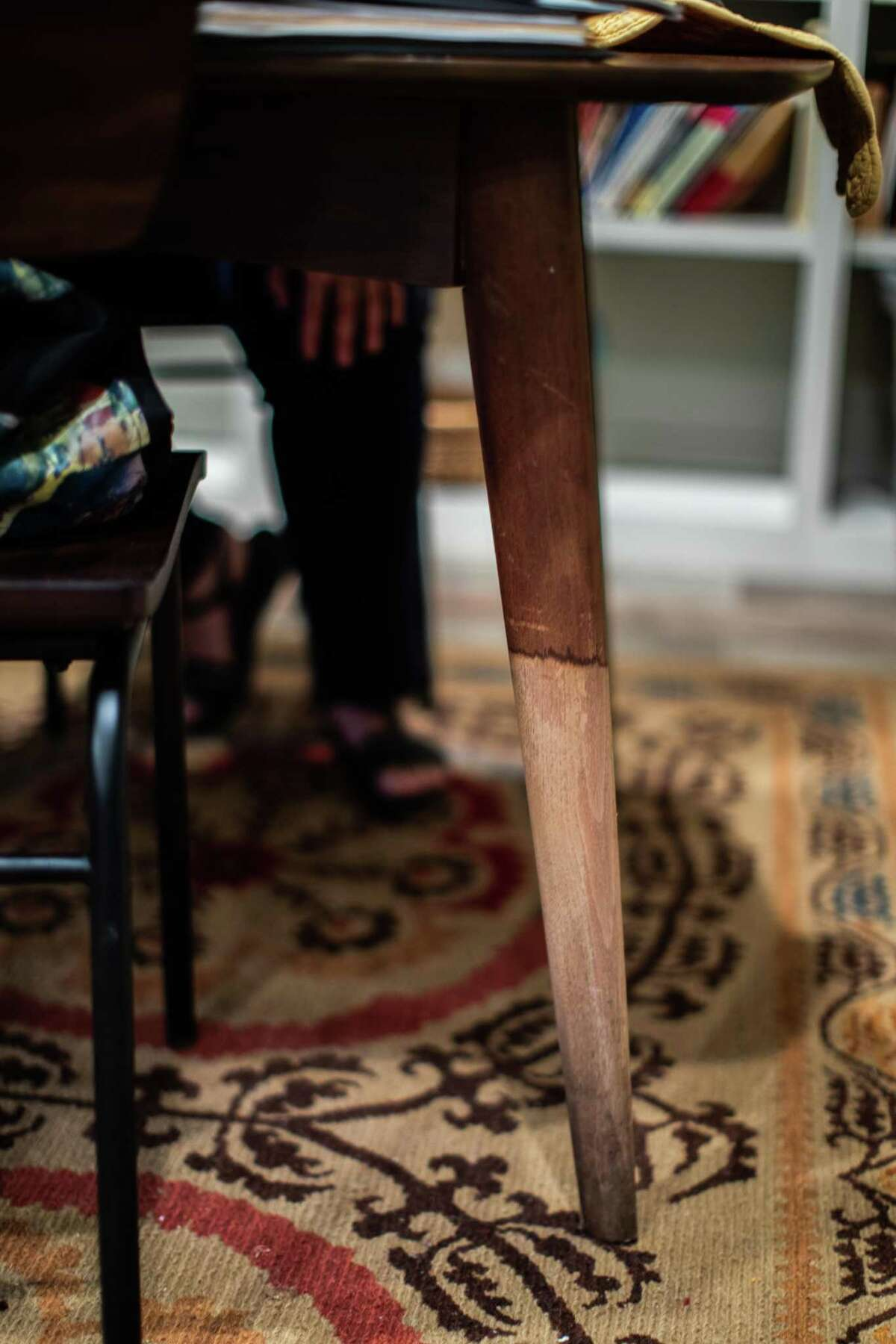 Leslie Friedrich's dining table still has a water stain from the time her home got flooded on the aftermath of Hurricane Harvey nearly four years ago. Wednesday, July 21, 2021, in Houston.