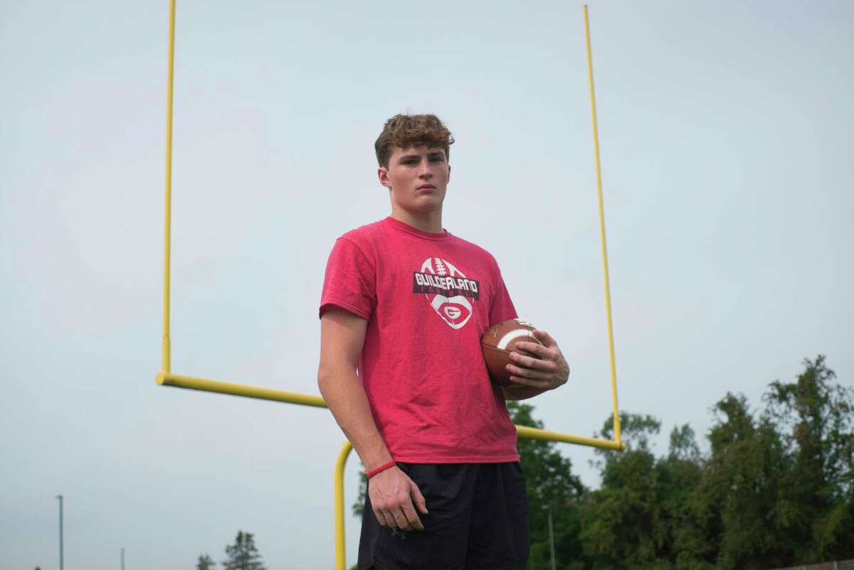Guilderland High School football player Mitch MacKissock at the high school working out earlier this month.
