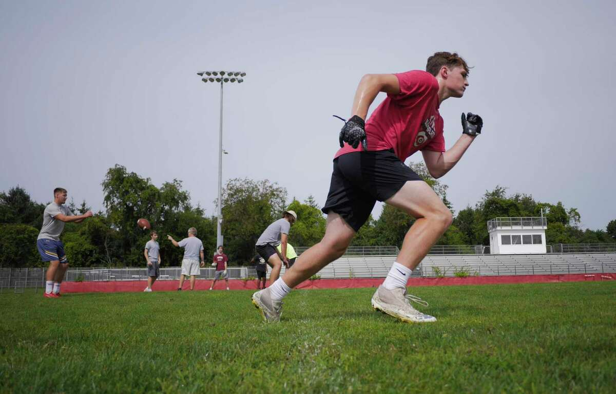 Guilderland High School football player Mitch MacKissock takes off to run a route as he practices pass-catching at the high school with teammates on Wednesday, Aug. 4, 2021, in Guilderland, N.Y.