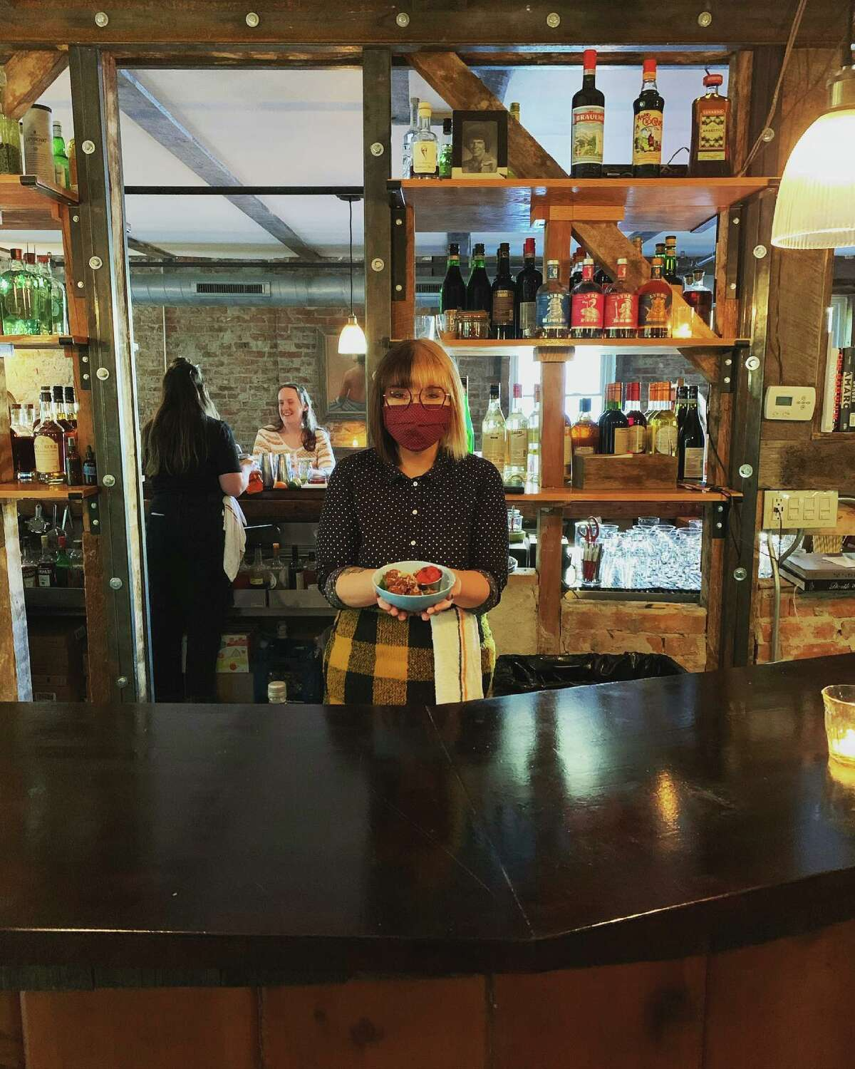 Marisa Cavanugh at the Tavern Bar, located above Donna's Italian restaurant in Troy, owned by Clark House Hospitality. The company began requiring all staff to wear masks again starting July 28. (Provided photo.)