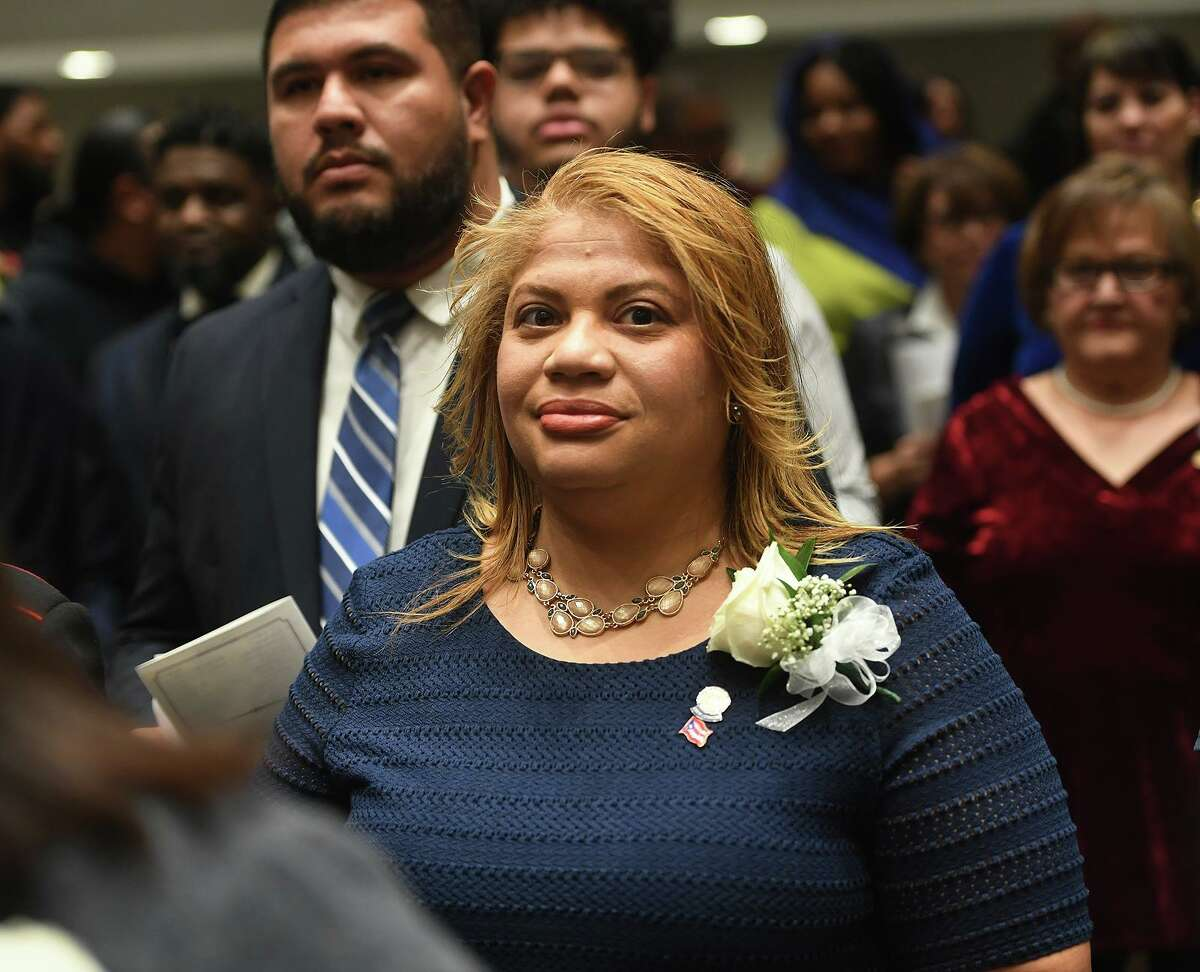 Newly re-elected City Council President Aidee Nieves marches in to the swearing in ceremony of city officials at City Hall in Bridgeport, Conn. on Thursday, November 28, 2019.