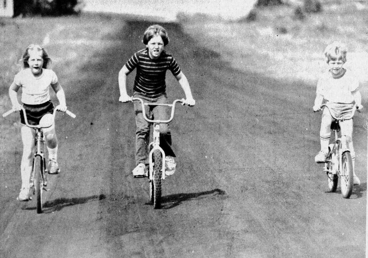 Warm weather and sunny skies brought out these young biking enthusiasts (from left) Lori Sorenson, Jason Pefley and Dale Sorenson. The youngsters took a trip down Second Avenue this morning. The photo was published in the News Advocate on Aug. 5, 1981. (Manistee County Historical Museum photo)