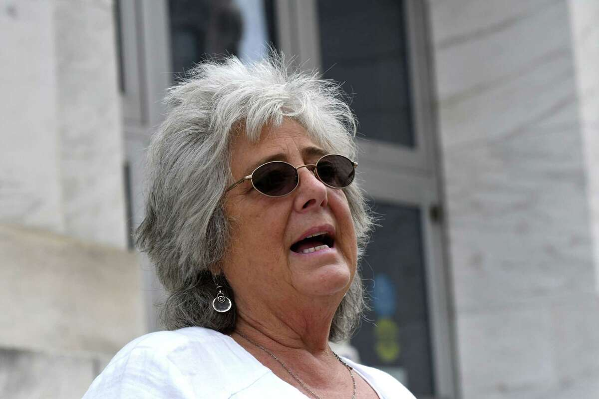 Bonnie Rosengrant, a victim of Michael Mann?•s $100 million bank fraud scheme that led to the collapse of his payroll company, MyPayrollHR, speaks to reporters outside James T. Foley U.S. Courthouse following Mann?•s sentencing on Wednesday, Aug. 4, 2021, in Albany N.Y. Rosengrant is the owner of the Hometown Diner in Rindge, N.H.